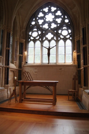 The flooring, pillars, and carvings are warm and inviting