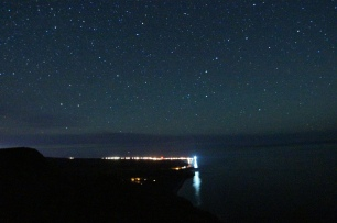 Stars above Cap-des-Rosiers lighthouse from Mont St-Alban lookout.